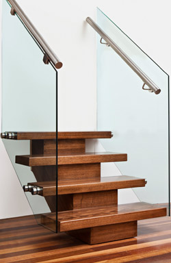Timber central spine with 12mm patch fitted glass and 50mm stainless steel <br />round handrail